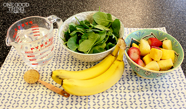 all green smoothie ingredients on table