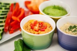 Bowls of various Hummus Flavors